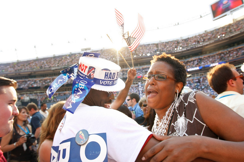8/28/08 - Denver, CO - Invesco Field - Democratic National Convention -<br /> Karen Russell, cq, delegate from Seattle, Washington (and daughter of the Celtics' Bill Russell) danced with Seattle, Washington delegate Chris Porter, cq. <br /> <br /> Senator Barack Obama will address an estimated crowd of 75,000 on the final night of the Democratic National Convention in Denver, CO on Thursday, August 28, 2008. Dina Rudick/Globe Staff.