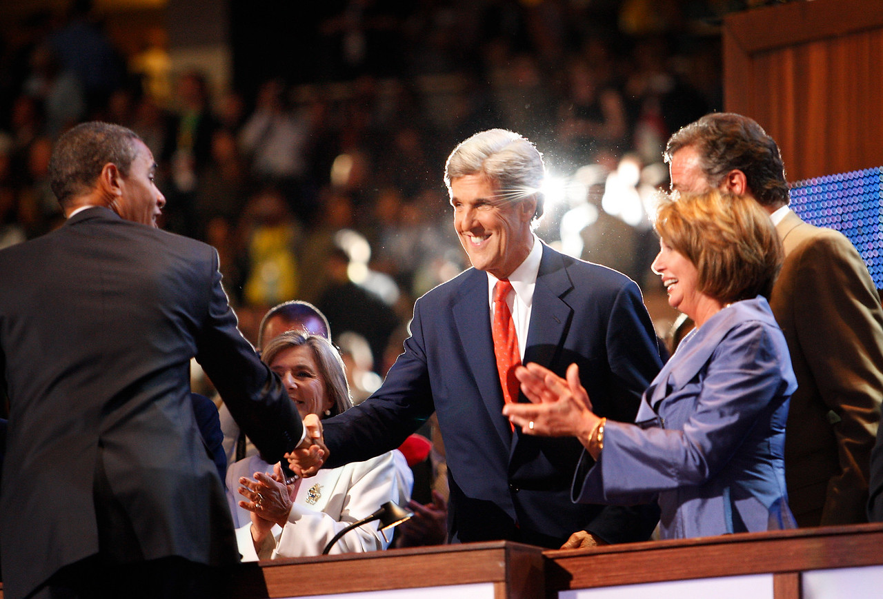 8/27/08 - Denver, CO - Pepsi Center -  Presidential nominee Barack Obama, left, shook hands with Senator John Kerry after appearing at the DNC on Wednesday night, August 27, 2008. At right is Speaker of the House, Nancy Pelosi.  Dina Rudick/Globe Staff.