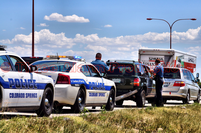 Colorado Springs Police Officers on the scene of a non-injury traffic accident, involving a tractor trailer vs. car on Southbound Powers Boulevard near Highway 24 in Colorado Springs, Colorado.