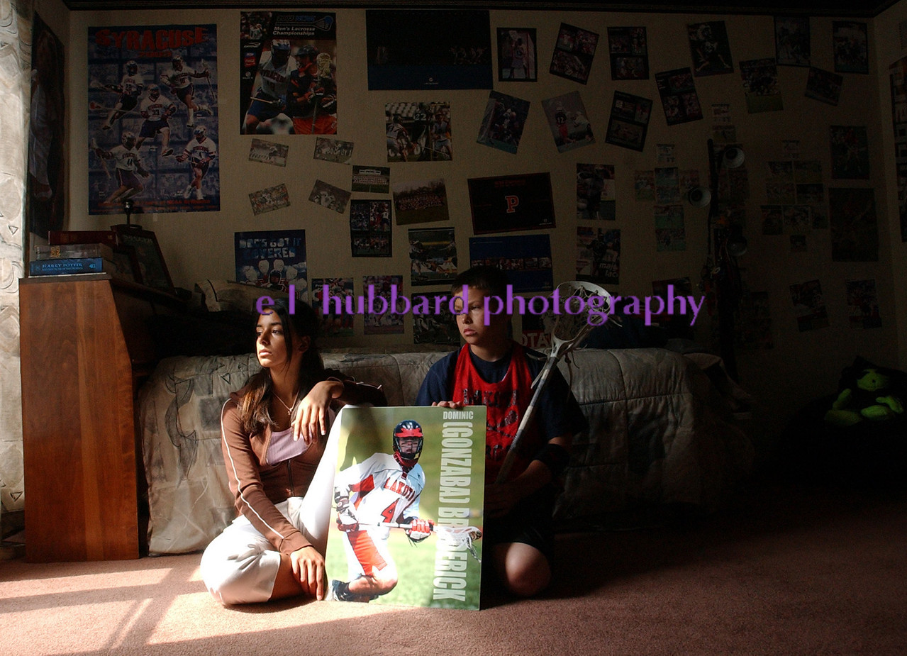 Brittany, 16, and Ryan, 10, Broderick, sit in their brother Dominic's room. Stephanie Broderick, the children's mother, has left the room unchanged since Dominic's death in an automobile accident in February 2004.<br /> Photo by E.L. HUBBARD
