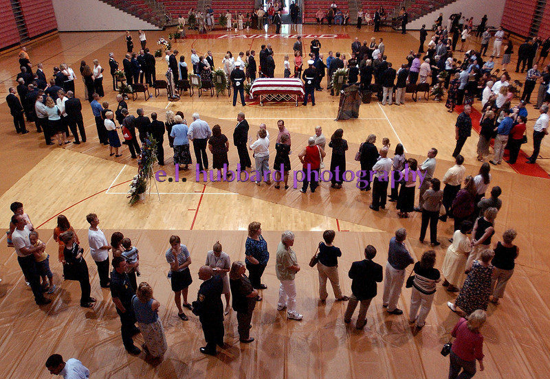 E.L. HUBBARD/JOURNALNEWS<br /> Mourners move slowly through the line to pay their respect to the family of Lance Cpl. Michael Cifuentes during visitation at Fairfield High School Sunday, 08/14/05.