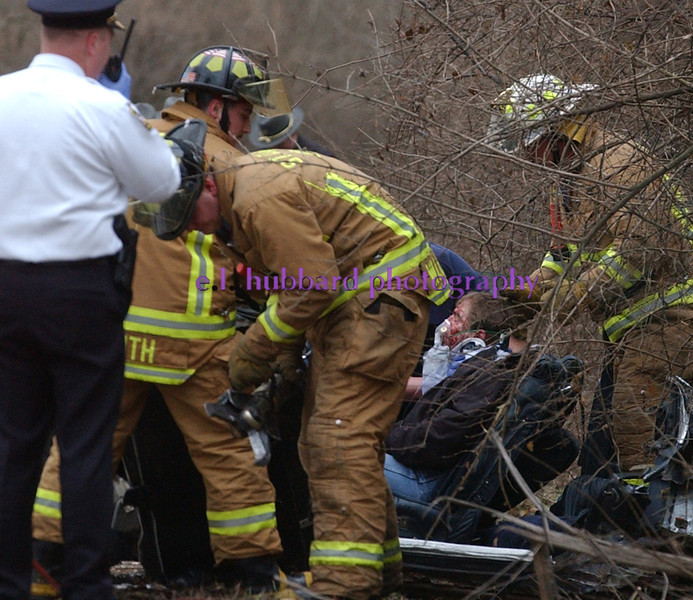 E.L. HUBBARD/JOURNALNEWS<br /> St. Clair Township rescue personnel extricate an accident victim from his vehicle after a one car accident on Augspurger Rd. east of Jackson Rd. Thursday, 01/05/06.