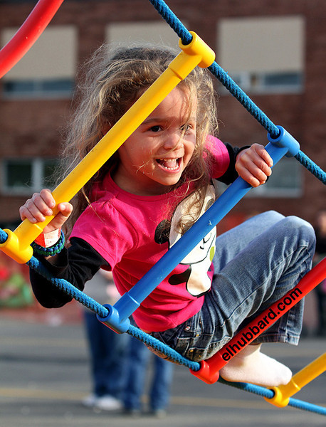 E.L. Hubbard photography<br /> Klara Hamblin, 5, laughs as she tries not to fall off the ladder during the Kramer Elementary School carnival in Oxford Saturday, Oct. 6, 2012.