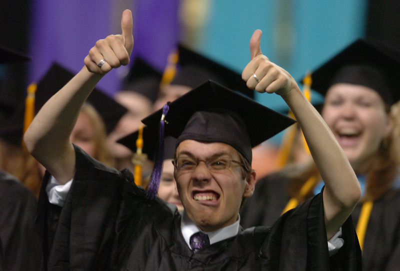 Bill Schaefer/Idaho State Journal<br /> A soon-to-be Century High School graduate gives the thumbs-up to the crowd during ceremonies Thursday afternoon at Holt Arena.