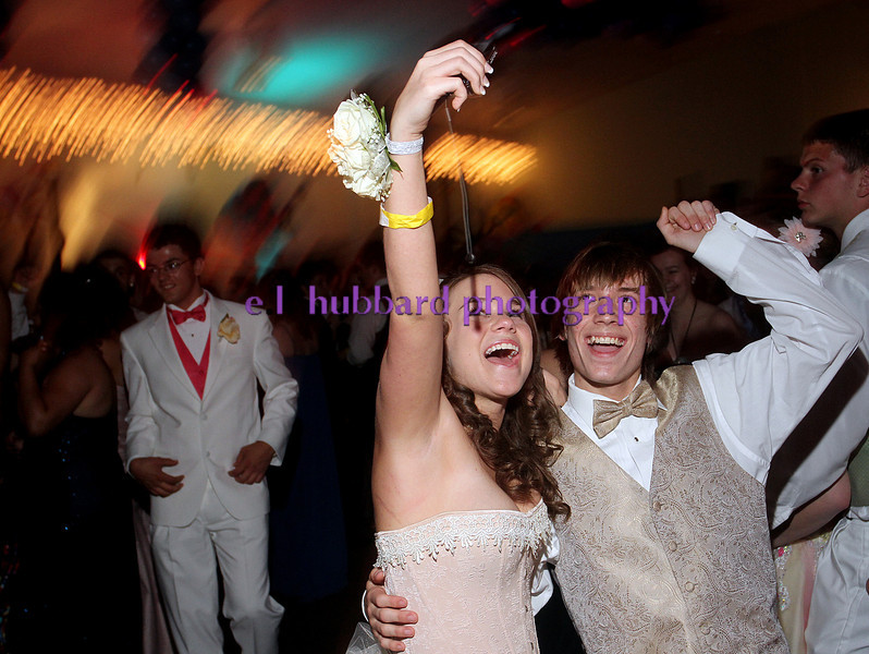 E.L. Hubbard photography<br /> Josalynn Smith, 17, and Elijah Paxson, 16, take their picture while dancing together during the Fairborn prom at the Greene County fairgrounds Saturday, May 19, 2012.