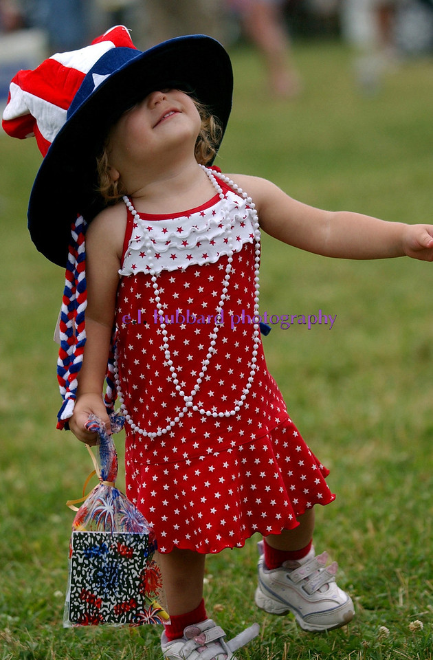 Carissa Gehr, 22 months, laughs as she tries to see her way around with a large patriotic hat over her eyes at the 4th of July Festival Tuesday, 07/04/06. Staff photo by E.L. Hubbard