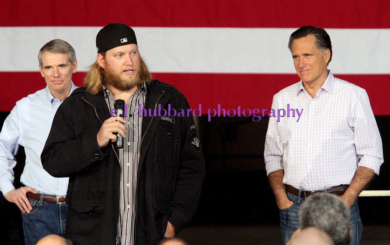 E.L. Hubbard photograpy<br /> Centerville native and former Ohio State football player, now with the New York Jets, Nick Mangold, introduces republican candidate for president, Mitt Romney, during a campaign stop at USAeroteam in Beavercreek Saturday, Mar. 3, 2012. To the left is U.S. Senator Rob Portman.
