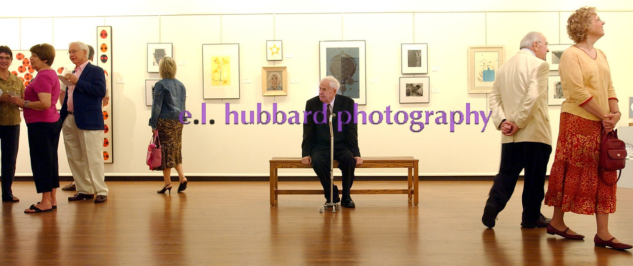 Charley Harper, seated, looks around during an exhibit of his works, along with his wife Edie's and son Brett's, at the Middletown Arts Center Friday, 8/11/06. Staff photo by E.L. Hubbard