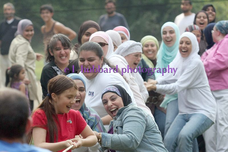The women beat the men in a game of tug-of-war during the annual CAIR Islamic Community picnic at Sharon Woods Sunday, August 24. 2008.