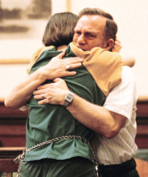 Renee Morrison gets a hug from her father following her arraignment for the shooting death of her mother in Judge Sage's courtroom Wednesday, July 23.<br /> AP Ohio 1st place