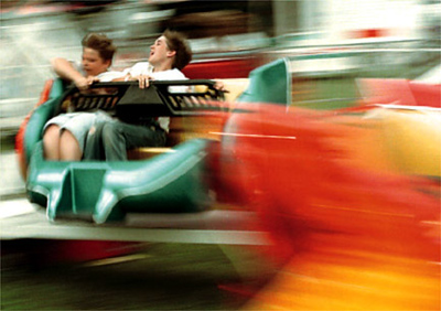 Two boys enjoy a ride at the fair.