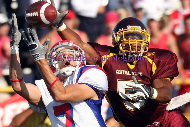 E.L. Hubbard for the Dayton Daily News<br /> UD receiver Steve Valentino catches a touchdown pass despite pressure from Central State's Marcus Clark in the first half at Welcome Stadium Sunday, August 31, 2008.