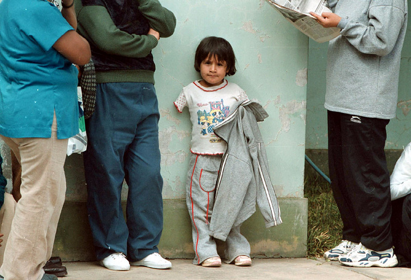Photo by Bill Schaefer<br /> Jacquelin Yacha-Garcia, 7, waits in the courtyard of the DeClercq Clinic to be seen by Prosthetist Randy Hamm. Jacquelin lost both arms when she fell in a pigpen four years ago. Randy Hamm had examined her during two previous trips but did not have the necessary materials to help her until this trip.