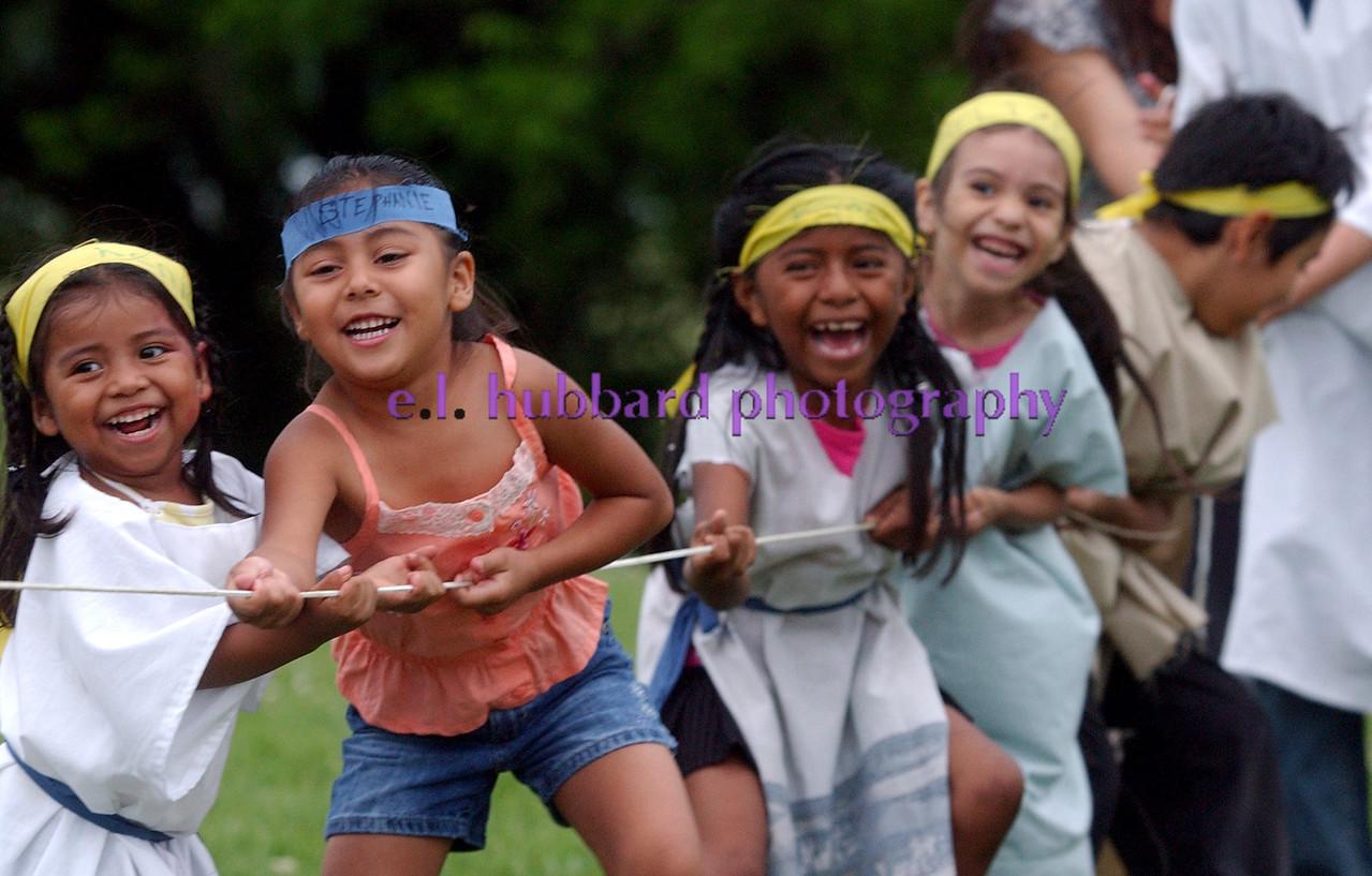 Kenia Gonzalez((CQ)), 3, Stephanie Reyes((CQ)), 5, Karen Gonzalez((CQ)), 8, and other children enjoy a game of tug-of-war at Hamilton Seventh-day Adventist Church((CQ)) during vacation bible school Wednesday, 07/12/06. Staff photo by E.L. Hubbard