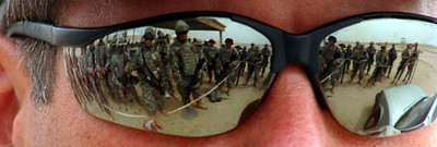 May 1, 2006:<br /> MPRI instructor Taft Yates sunglasses reflect members of the 1016th attending his Entry Control Point class.