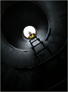 City of Erie sewer maintenance supervisor Paul Stano, 50, looks down into a sanitary sewer on Chestnut Street in Erie on Wednesday, March 19, 2014