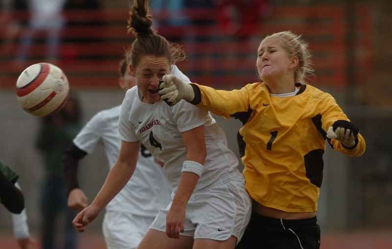 Journal photo by Bill Schaefer<br /> Idaho State University's Chantal Kim (4) collides with Sacramento State goalie Mandy Trojan (1) while trying to score during the second overtime period of the Big Sky Soccer championship Sunday afternoon at Davis Field.