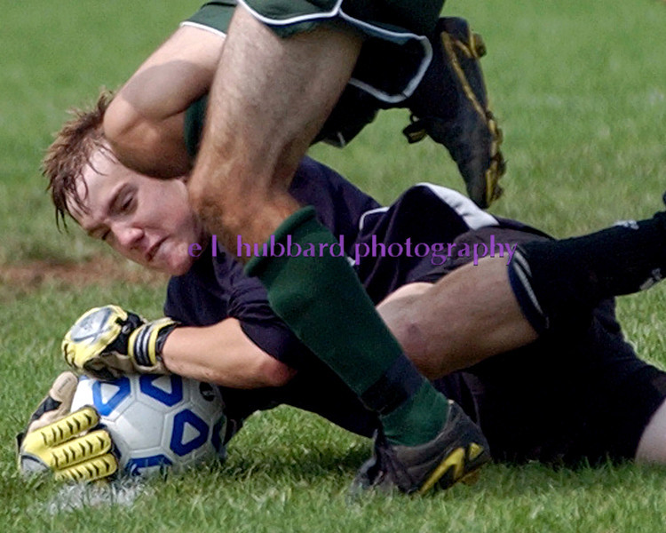 E.L. HUBBARD/JOURNALNEWS<br /> Hamilton High keeper Christopher Hubbard makes a stop while under pressure from Badin midfielder Andrew Burch in the first half at Hamilton Soccer Stadium Saturday, 09/24/05.