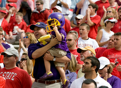 In a sea of red Wolfpack fans, ECU fans stand tall cheering on the Pirates at Carter-Finley Stadium.
