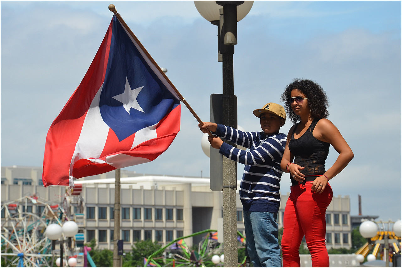 Khari Sánchez and his cousin Kathy Cruz watch the parade on Tremont Street.