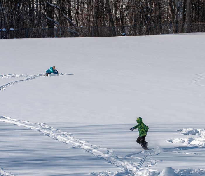 Gabe Newson, of Auburn, Maine, runs through the snow after sledding down the hill behind Sherwood Heights Elementary School in Auburn on Monday afternoon, January 20, 2020. Visit sunjournal.com to watch a video starring Newson.
