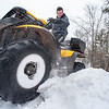 After finishing online classes from Poland Regional High School, Matt Bessette jumped on his ATV and drove around his house in Minot Tuesday afternoon but didn't have enough speed going up a hill by his driveway and got stuck.  After shoveling underneath, he jumped back on and goosed the throttle while rocking it back and forth until he got unstuck.