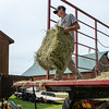 "Owen Estes helps his father Deryk unload bales of hay at the Murch farm in Oxford where the older Estes works.  ""It's gets him away from the X-box while earning money to buy a new game."" said Deryk before grabbing another bale."