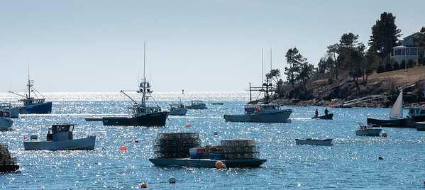After moring their boat in the harbor a pair of fishermen head to shore in Mackrel Cove on Saturday, March 21, 2020.