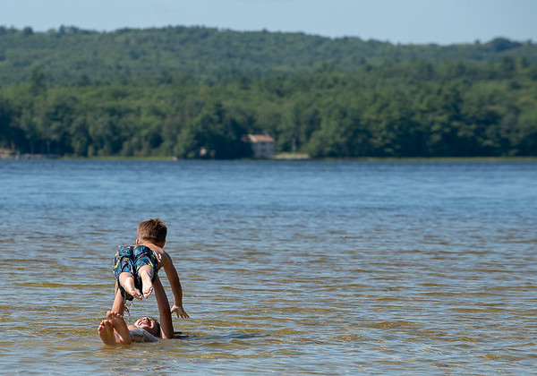 There were few people on the beach and swimming on Taylor Pond in Auburn, Maine Monday afternoon August 26, 2019 at Crescent Beach except for a few stretching their summer vacation.  Gianna Balestrino and her brother Xander relax after splasing around all afternoon on the last day of their vacation before heading back to start school this week in Glens Falls New York.