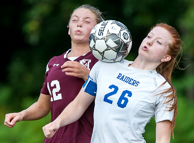 Monmouth's Jordyn Gowell, left and Oak Hill's Sadie Waterman battle for the ball during Tuesday's game in Monmouth.  (Russ Dillingham/Sun Journal)