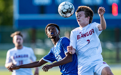 Lewistons Suab Nur, left and Bangor's Dylan Gerrish battle for the ball during the first half of Friday night's soccer match against Bangor at Lewiston High School.