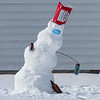 A beer themed snowman gets a little sideways in a P.U.G. (Pop-Up Garden) on Bartlett Street between Pine and Walnut Streets in Lewiston Tuesday morning.