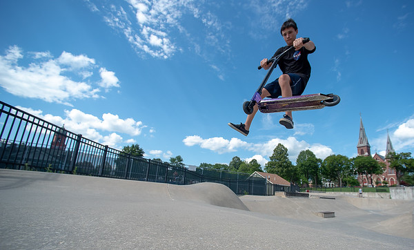 Jason Snow of Lewiston flies out of a bowl in the Lewiston Skatepark Wednesday afternoon.  He was practicing spinning the scooter around and landing back on it.