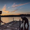 "Mark Arel, left, picks up a monkey wrench to hand to his brother Dan, right, as they haul a section of a dock from Middle Range Pond in Poland at dusk on November 9, 2020. He was with a crew from What's Up Docks removing them from Cyndi's Dockside Restaurant & Boathouse.  ""We would be doing this in any weather so we lucked out with this sweet stretch."" said Arel as he and his brother walked a section onto dry land."