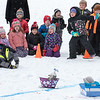 Students from Mrs. Spencer's kindergarten class cheer while other students react as the winning sled crosses the finish line during Friday's race at Sabattus Primary School during their Winter Games. Visit sunjournal.com to watch a video of the final race where the three winners from each grade competed to determine which sled would be replicated with a 3D machine during the final week of their Winter Games later this month where the theme will be technology.