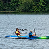 A pair of kayakers paddle past a loon on North Pond in Woodstock Saturay afternoon.