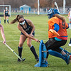 Mountain Valley's Autumn Freeman, left, can't get to Dirigo's Grace Robbins as she takes a shot on goal past Mountain Valley goalie Brooke Brown. Dirigo's Lizzie White was waiting in front of the goal and hit it in to score the final goal of the game during Dirigo's 6-4 victory in Rumford.