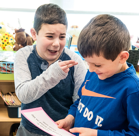 """Farwell Elementary School second grader Myles Arneault, points to his experiement partner, Parker Crafts, right, and says """"You are going to wipe the toilet seat, not me."""" as Parker reads the instructions the two were tasked with during Wednesday's project at the Lewiston school.  (Russ Dillingham/Sun Journal)"""