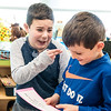 "Farwell Elementary School second grader Myles Arneault, points to his experiement partner, Parker Crafts, right, and says ""You are going to wipe the toilet seat, not me."" as Parker reads the instructions the two were tasked with during Wednesday's project at the Lewiston school.  (Russ Dillingham/Sun Journal)"