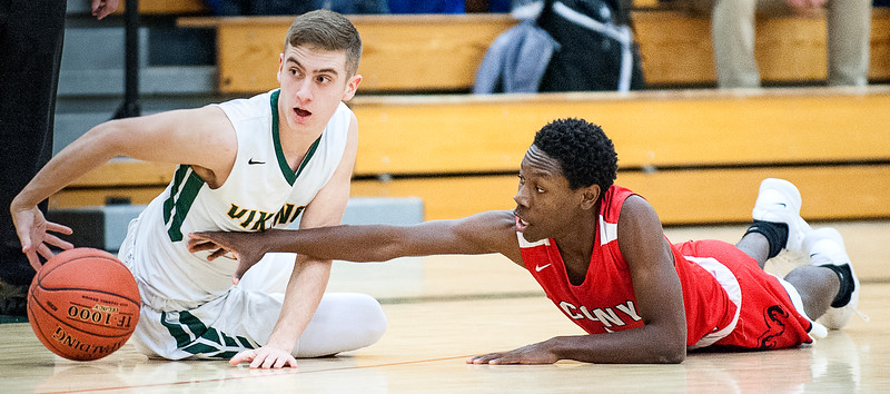 Oxford Hill's Garrett Record, left and Cony's Simon McCormick scramble for a loose ball during the first half of Thursday's game in Paris.  An alert teammate called a time out for Oxford Hills. (SUN JOURNAL PHOTO BY RUSS DILLINGHAM)