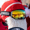 Santa's getting together for Sunday Santa at Sunday River in Newry, Maine are reflected in the goggles of snowboarder Jaden Bao, of South Portland, Maine on December 8, 2019.