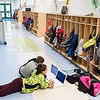 Farwell Elementary School principal Amanda Winslow checks in on a pair of 3rd graders working on their computers in the hall of the Lewiston school Monday afternoon, November 6, 2018.  (Russ Dillingham/Sun Journal)