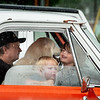 Jim Myrick and his grandsons Sabre, middle, and Zayden and their dog Jackson wait out the rain in the parking lot at the rally point for Saturday's Festival of Hope Parade in Bethel where he drove his vintage truck in the parade.