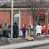 People wait in line for the ATM and walk up teller at Community Credit Union on Pine Street in Lewiston early Wednesday morning.  Lewiston Police Officer Alexander Markellos was partolling the parking lot to make sure nobody cut the lines and to keep order as long lines started when it opened at 6 am and are expected all day as Social Security and disability payments become available.  Markellos expects the longest lines and most traffic congestion between noon and 2:00 this afternoon.