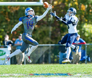 Oak Hill's Samuel Lindsay, left nearly intercepts a pass intended for Poland's Isaiah Hill during the first half of Saturday's football game in Wales. (Russ Dillingham/Sun Journal)