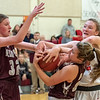 Gray-New Gloucester's Jordan Grant, back, wrestles for the ball with Freeport's Mason Baker-Schlendering, left and Caroline Smith during Thursday's game in Gray.