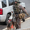 A state police tactical team member with his K-9 heads to the scene.