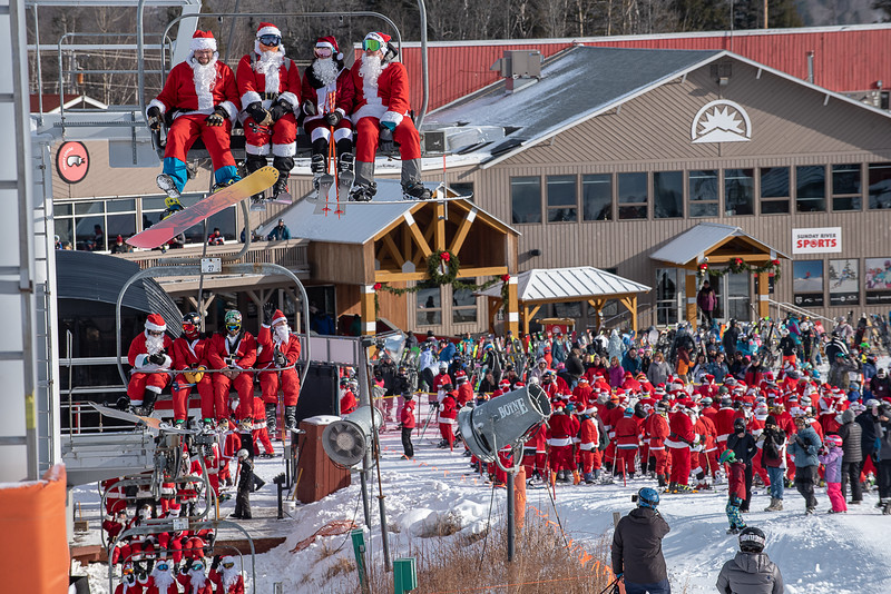 A sea of red from 240 people who dressed up like Santa ride the lift at Sunday River in Newry, Maine Sunday morning, December 8, 2019 during the 20th annual Santa Sunday where they raised $6,200.