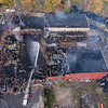 An aerial view Monday morning October 15, 2018 shows the fire scene in Mechanic Falls where a massive fire destroyed a historic mill. The complex served several businesses, including as a warehouse for Maine Cycle, and was filled with motorcycles and parts. Corcoran Environmental Services, which recycles plastics, also operated at the mill.<br /> According to Zachary Maher, town manager in Mechanic Falls, the building is owned by Charles Starbird.  (Russ Dillingham/Sun Journal Aerial)