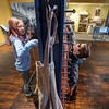 "Aubrey Collins, left and her brother Myles, of Lewiston try out one of several interactive activities at Museum L-A in Lewiston Thrusday afternoon.  The weaving kiosk is part of ""All Work and No Play,"" an exhibit that delves into America's industrial labor history. The exhibit explores the historic use of children as laborers in industries such as textile mills, sardine canneries and family farms throughout the state of Maine.  For more information on the exhibit and museum visit their website  <a href=""http://www.museumla.org"">http://www.museumla.org</a>"
